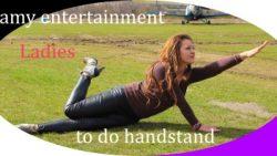 Ladies do the handstand in heels and wetlookleggings
